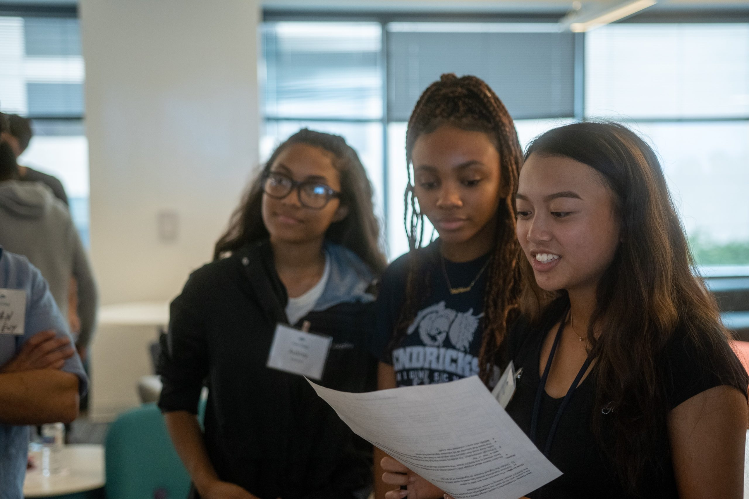 Aubrey VanZandt (C2C '20), Monae Thompson (C2C '19), Angelyna Le (C2C '20) playing an epic game of Code2College BINGO at our RetailMeNot Workshop (September 2019)